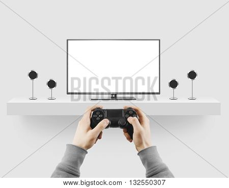 Man hold gamepad in hands in front of blank tv screen mock up playing game. Clear monitor mockup with gamer first person. Video gaiming console screen display. Gamer play game pad on tv screen.