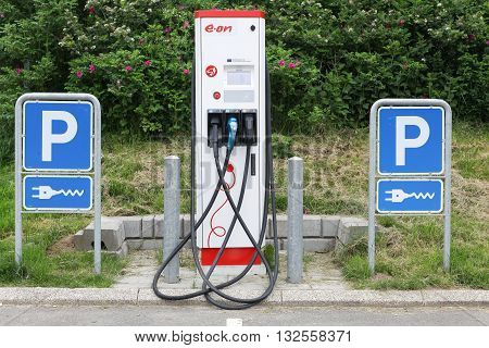 Vejle, Denmark - May 29, 2016: Eon charging point for electric cars. Eon is one of the world's largest investor owned electric utility service providers and operates in over 30 countries