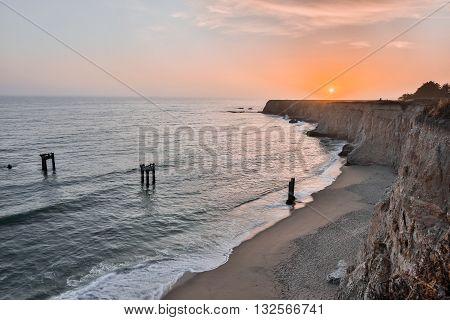 Sunset over Davenport Pier Beach. Abandoned Pier Beach, Davenport, Santa Cruz County, California