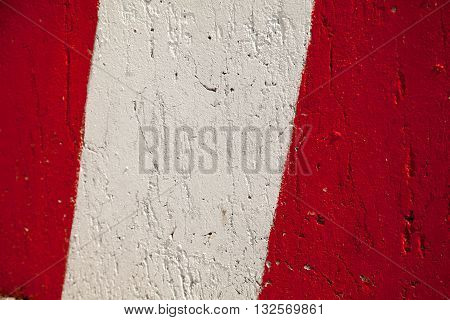 Red white stripes park stop marking abstract warning sign textured background