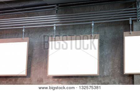 Hanging blank board with grey background, stock photo