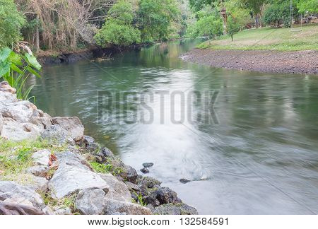River in the Jungle. Small river in jungle. clean natural environment and light Reflections on the river (blurred surface river)