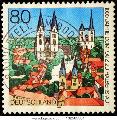 MOSCOW RUSSIA - JUNE 02 2016: A stamp printed in Germany shows the ancient German city devoted to the 1000th Anniversary of the Cathedral Square in Halberstadt circa 1996