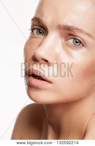 Young Woman With Helthy Skin And Strobing Highlights