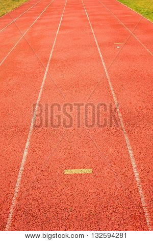 Yellow Marks. White Lines And Texture Of Running Racetrack, Red Racetrack,  In Outdoor Stadium
