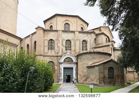 RAVENNA,ITALY-AUGUST 21,2015:people stroll in front the entrance of the San Vitale basilica in Ravenna-Italyduring a cloudy day .