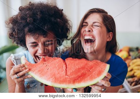 Two Young Girls Enjoying A Watermelon