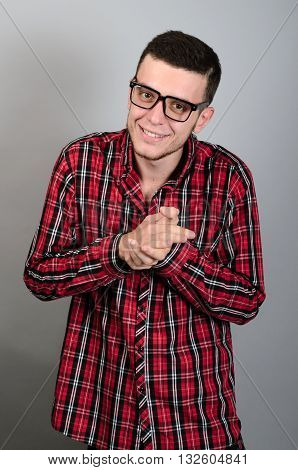 Portrait Of Young Man Rubbing Palm Crafty