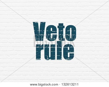 Political concept: Painted blue text Veto Rule on White Brick wall background