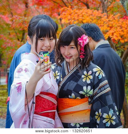 KYOTO JAPAN - NOVEMBER 22 2015: Unidentified young Japanese women take selfie with a mobilephone