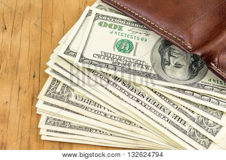 Leather Wallet And Dollar Bills Falling Out
