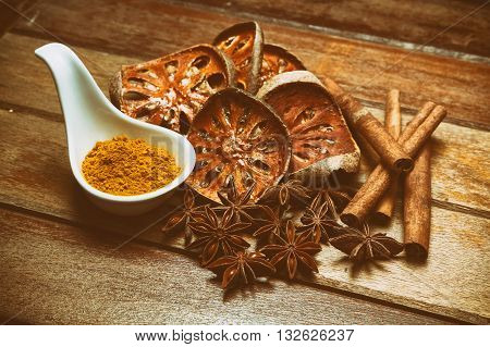 Alternative health care dried various herbs in wooden background