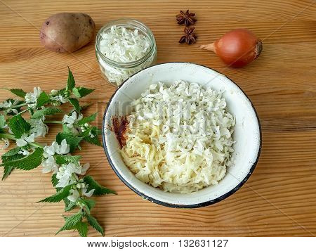 Nettles flowers with potatoes onion and spices burgers cooking organic food