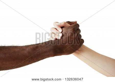 Arm Wrestling Against Racism. Black And White Human Holding Hands In A Handshake, Showing Friendship