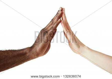 Interracial Friendship And Cooperation Concept. Two People Od Different Ethnicities Holding Hands In