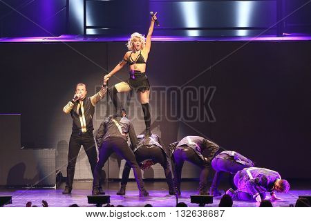 NEW YORK-JUL 9: Derek Hough (L) and Julianne Hough (top) perform on stage during the Move Live On Tour at Radio City Music Hall on July 9, 2015 in New York City.