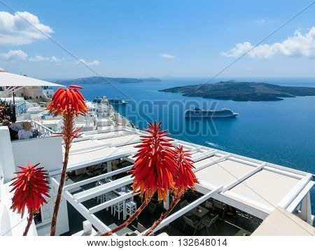 Oia Greece - June 10 2015: Santorini - The restaurant geared to romantic diner in Oia (Ia) and the sea in the background. Beautiful terrace with sea view on Santorini island Oia Greece.