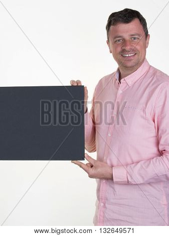 Man in pink with a blanck black board isolated