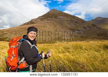 Woman Hiker Posing At The Foot Of Carrauntoohil