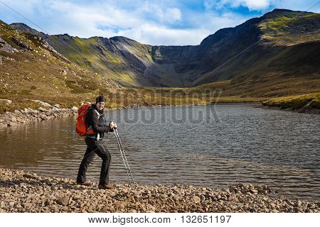 Female Hiker Posing Lake Side In The Mountains