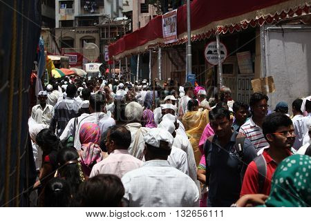 Pune India - July 11 2015: Thousands of people throng to a pilgrimmage in India during the Wari festival