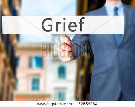 Grief - Businessman Hand Holding Sign