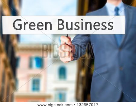 Green Business  - Businessman Hand Holding Sign
