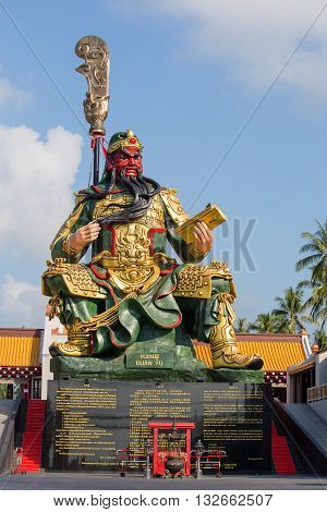 KOH SAMUI THAILAND - APRIL 23 2016 : Statue of Guan Yu in Samui. Shrine Guan yu is a Chinese godwho have red face god