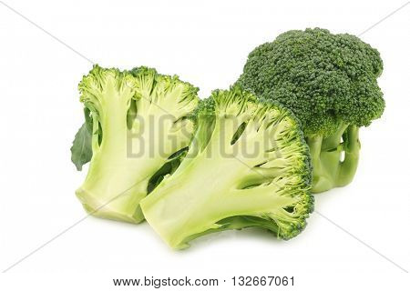 Fresh broccoli floret and a cut one on a white background
