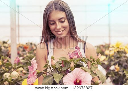Young Flower Seller Takes Care Of Her Beautiful Flowers