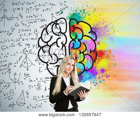 Right and left hemispheres creative and analytical thinking concept with businesswoman holding book on background divided into colorful and mathematical formula walls
