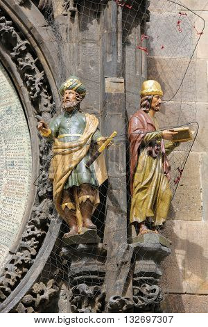 Statues Of Astronomer And Chronicler At Prague Astronomical Clock