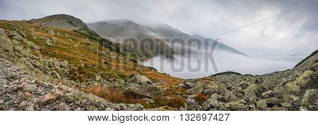 Mountains Landscape with Fog in Ziarska Valley. Rocks in Foreground.