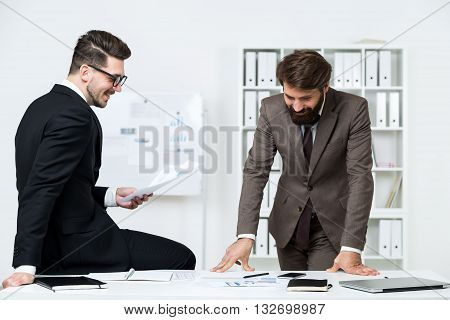 Businesspeople Doing Paperwork And Laughing