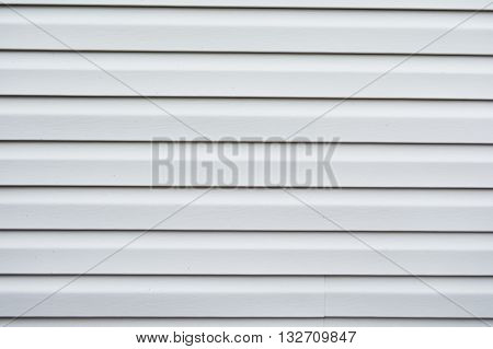 Gray vinyl siding background with horizontal lines
