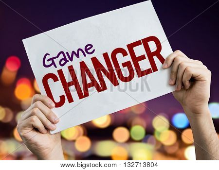 Game Changer placard with night lights on background