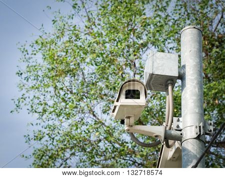 CCTV (Closed-circuit television) Security Camera in public park.