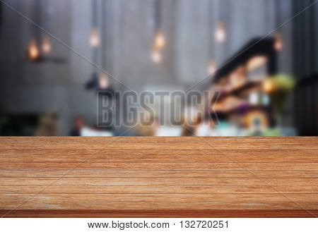 Top wooden table with blurred cafe background, stock photo