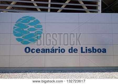 LISBON, PORTUGAL - JUNE 16, 2015: Logo in front of the facade of the Lisbon Oceanarium modern building, Portugal