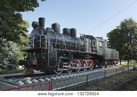 SLOVIANSK UKRAINE - AUGUST 1 2010: Steam locomotive - a museum piece near Sloviansk locomotive depot. With this locomotive driver Petro Krivonos set traffic records in the 30-ies of XX century