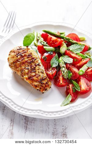 Grilled Chicken Breast with Asparagus and Cherry Tomato Salad with Herbs and Chia Seeds
