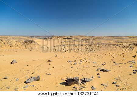 Sandy desert near Nubian village in Egypt.