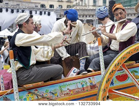 Naples Italy. May 29 2016: Musicians at the parade of carriages with actors and players in costumes to commemorate the three hundredth anniversary of the birth of Charles of Spain who was King of Naples