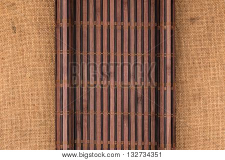 Bamboo mat in the form of a manuscript on sackcloth top view
