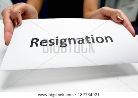 Close up Resignation paper in a woman's hands