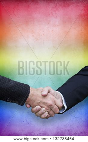 close up of handshake with rainbow colors for gay pride
