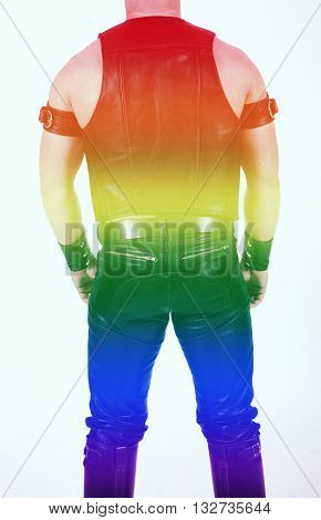 backside of a leathermen dressed in black fetish gear with rainbow colors for gay pride