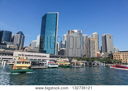 View of Circular Quay from the water showing the CBD skyline and Sydney's famous ferrys which you can travel on the beautiful harbour.