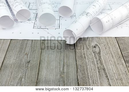 Architectural Blueprints With Floor Plan On Gray Wooden Background
