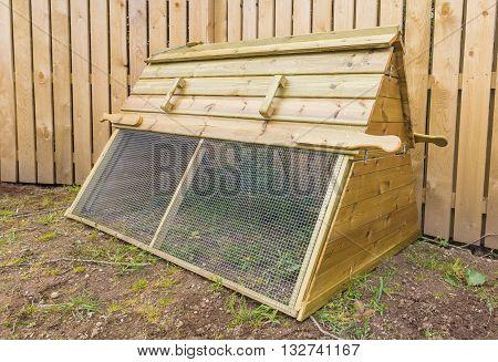 Wooden chicken coop ark in domestic garden